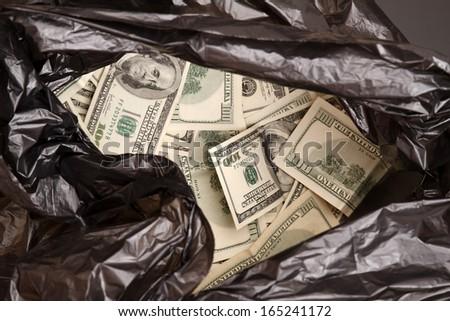 A Rubbish bag full of dollars   - stock photo