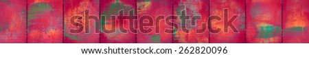 A rubine red grungy panoramic background of metal sheets - stock photo