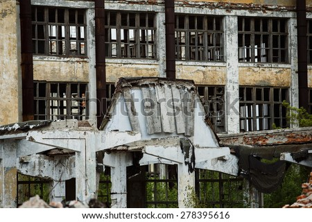 A ruined building of a plant with a row of empty windows. Concept of disaster, war. Retreat for homeless. - stock photo