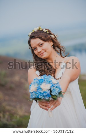 a runaway bride dancing on a field - stock photo
