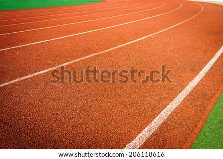 A running racetrack constructed from red rubber cover - stock photo