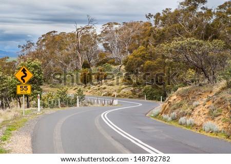 A rural winding road near Bothwell in Tasmania, Australia - stock photo
