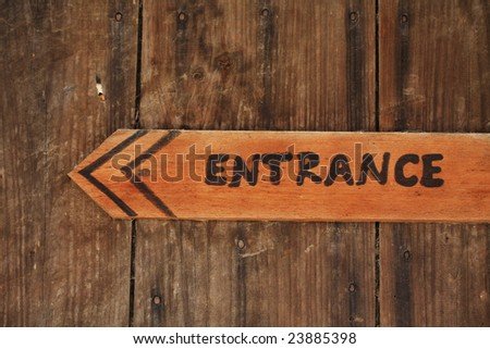 """A rustic """"entrance"""" sign. - stock photo"""