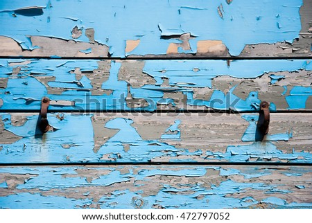 A rustic flaking Blue paint wood background