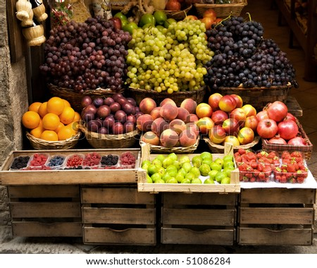A rustic Italian storefront  featuring a colorful variety of delicious fruit.