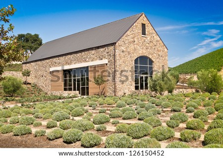 A rustic stone building captures the ambiance of California wine country - stock photo