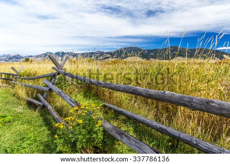 A rustic wooden fence at the edge of Cherry Creek Nature Preserve on the outskirts of Bozeman, Montana - stock photo