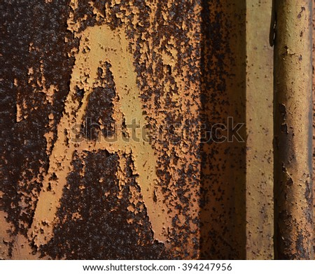 A rusty background texture with letter A - stock photo