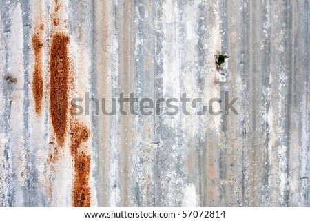 A rusty corrugated iron metal fence close up - stock photo