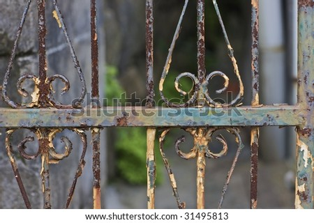 A rusty gate leading to a small garden in Sasebo, Japan (http://www.artistovision.com/outdoors/rusty-gate.html).