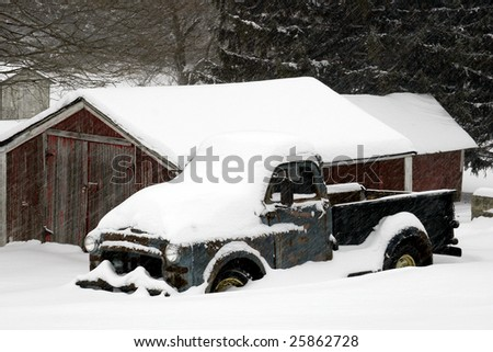 a 1950's era pickup truck in a snow storm
