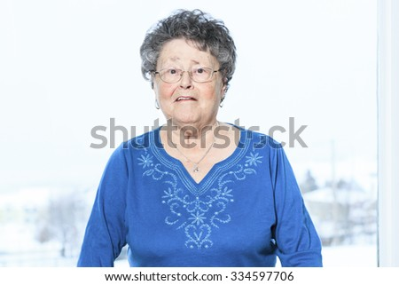 A 80s senior person with is walker - stock photo