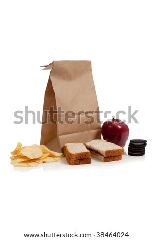 A sack lunch with peanut butter sandwich and a apple - stock photo