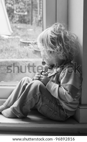 A sad little boy - stock photo