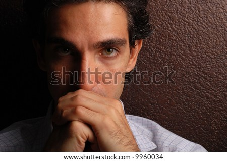 a sad man praying for his problems to be resolved - stock photo