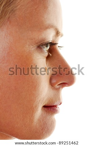 a sad woman with tears on her face - stock photo