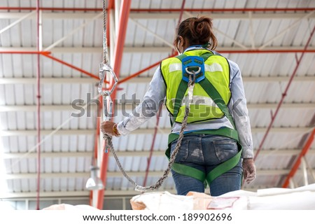 A safety harness is a form of protective equipment designed to protect a person, animal, or object from injury or damage. The harness is an attachment between a stationary and non-stationary object - stock photo