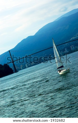 A sailboat in front of Vancouver Lions Gate bridge. More with keyword group14d