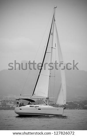 a sailboat navigating on the mediterranean sea - stock photo