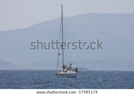 A sailing boat or yacht at sea off the coast of Cesme Turkey