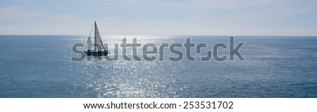 A sailing boat, yacht on a beautiful sunny day - stock photo