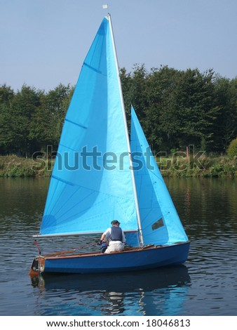 A Sailing Dingy on a River.