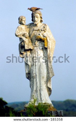 A saint with a pigeon. - stock photo