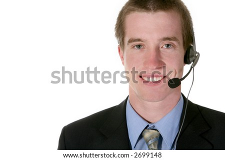 A sales man with a telephone earpiece trying to make the sale