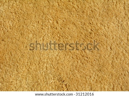 A sample of brown textured carpeting. - stock photo