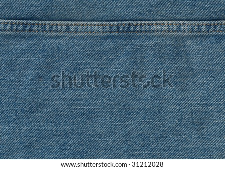 A sample swatch of denim with a seam. - stock photo