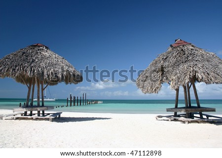 A sand beach with two small summerhouse of small island  in Varadero, Cuba. - stock photo
