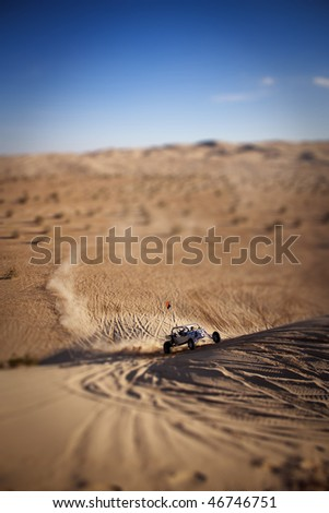 A Sand Rail coming up the side of a dune - stock photo