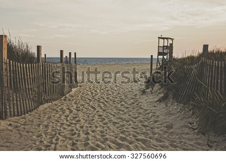 A sandy beach at dusk with vintage matte tone. - stock photo