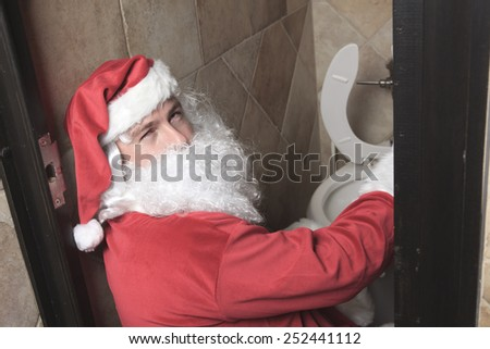 A santa claud sic in the bar toilet