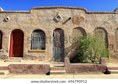 A Santa Fe Style Building In Tucsonu0027s Historic District Features A Colorful Red  Door And
