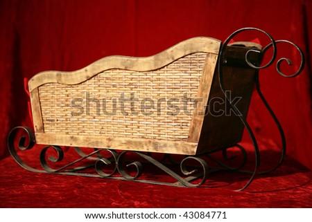 a santa sled on a red velvet background - stock photo
