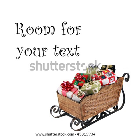 """a """"santa sleigh"""" filled with presents """"isolated on white"""" with """"room for text"""" - stock photo"""
