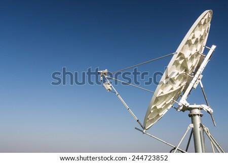A satellite dish parabolic antenna communications satellites, which transmit data transmissions - stock photo