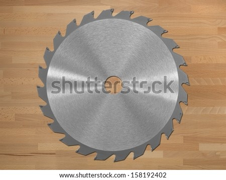 A saw blade isolated against a wooden background