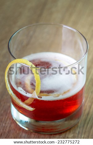 A Sazerac cocktail isolated on a wooden table