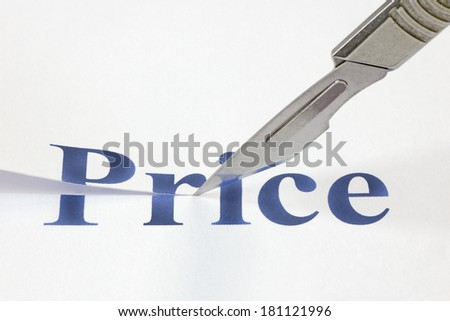 A scalpel cutting through the word Price. Concept denoting a cut in price to encourage more spending or due to a poor economic performance. - stock photo