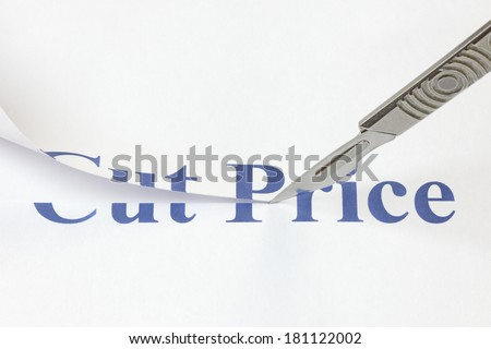 A scalpel cutting through the words Cut Price. Concept denoting a cut in price to encourage more spending or due to a poor economic performance. - stock photo