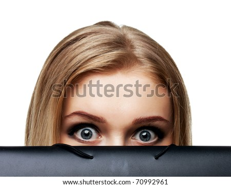 a scared young woman standing behind a folder, isolated on white - stock photo