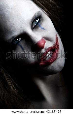 a scary and evil looking female clown