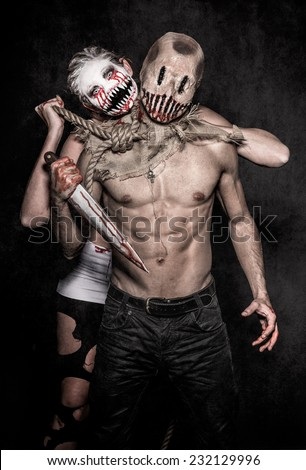 a scary demon woman and a killer monster - stock photo
