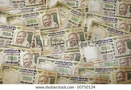 A scattering of 500 rupee notes - stock photo