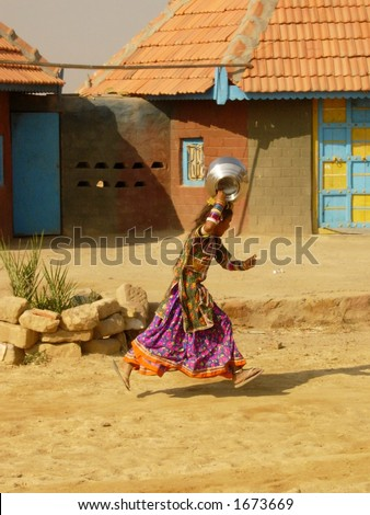 a scene of a village in india - stock photo