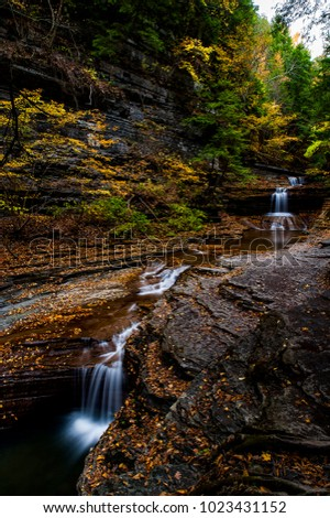 A scenic, autumn view of cascades at Buttermilk Falls State Park in Ithaca, New York.