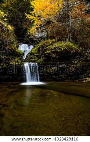 A scenic, autumn view of Curtain Cascade within the Havana Glen near Watkins Glen and Montour Falls, New York.