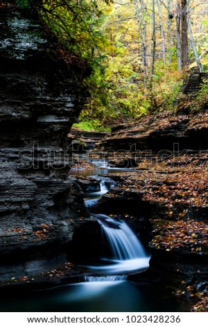 A scenic, autumn view of some peaceful cascades at Buttermilk Falls State Park in Ithaca, New York.
